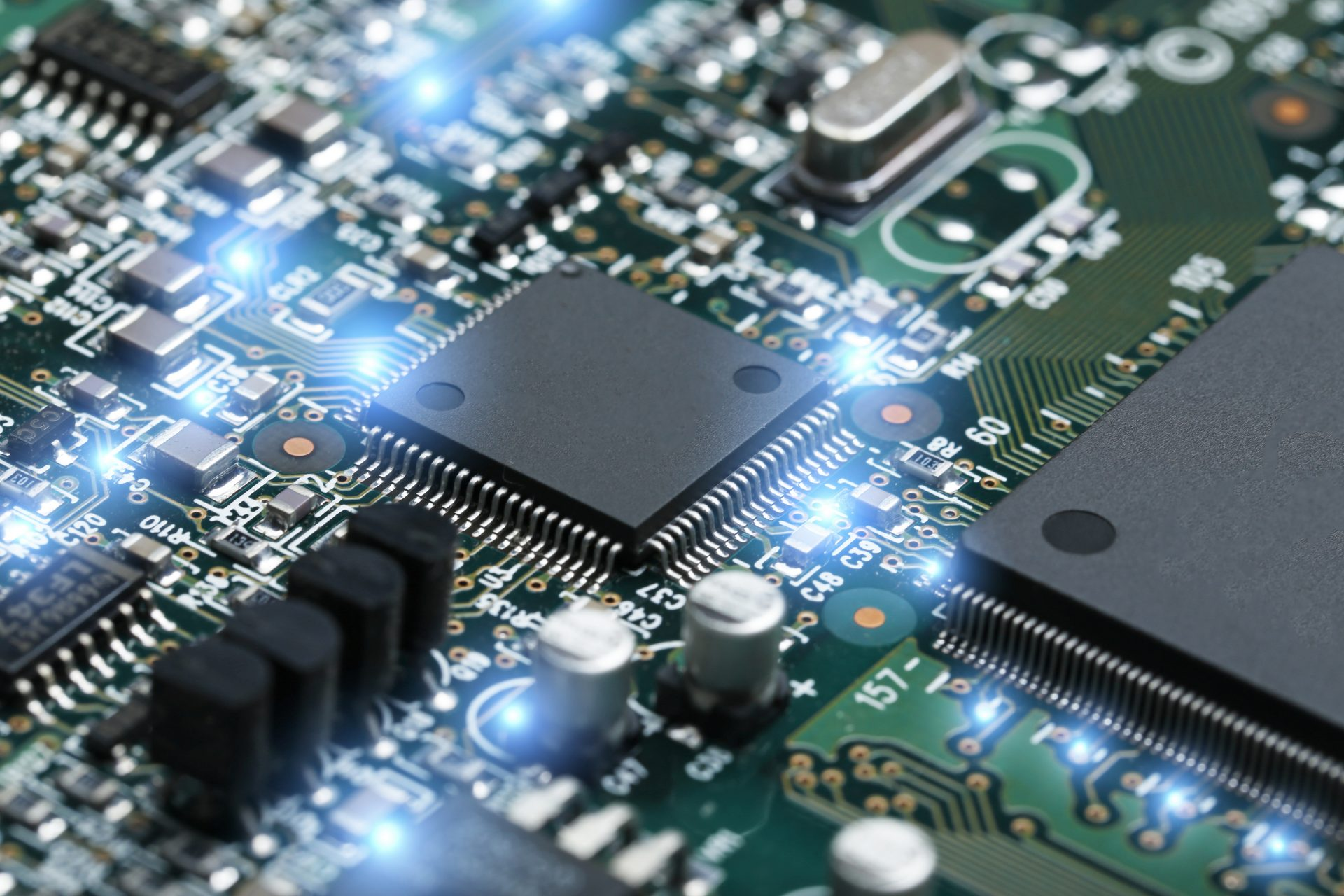 a close up of a circuit board including a microchip